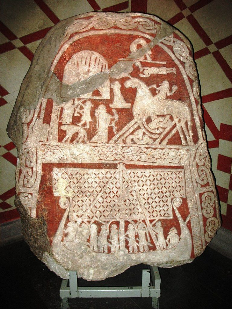 Viking picture stone as the Viking odin artifact depicing Odin coming to Valhalla on his Sleipnir horse