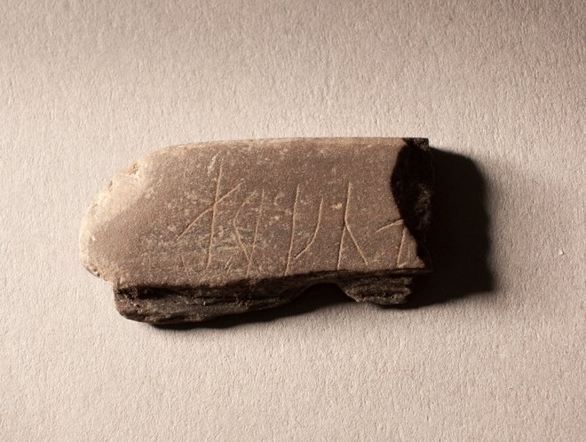 Viking whetstone with the unclear runic insciption